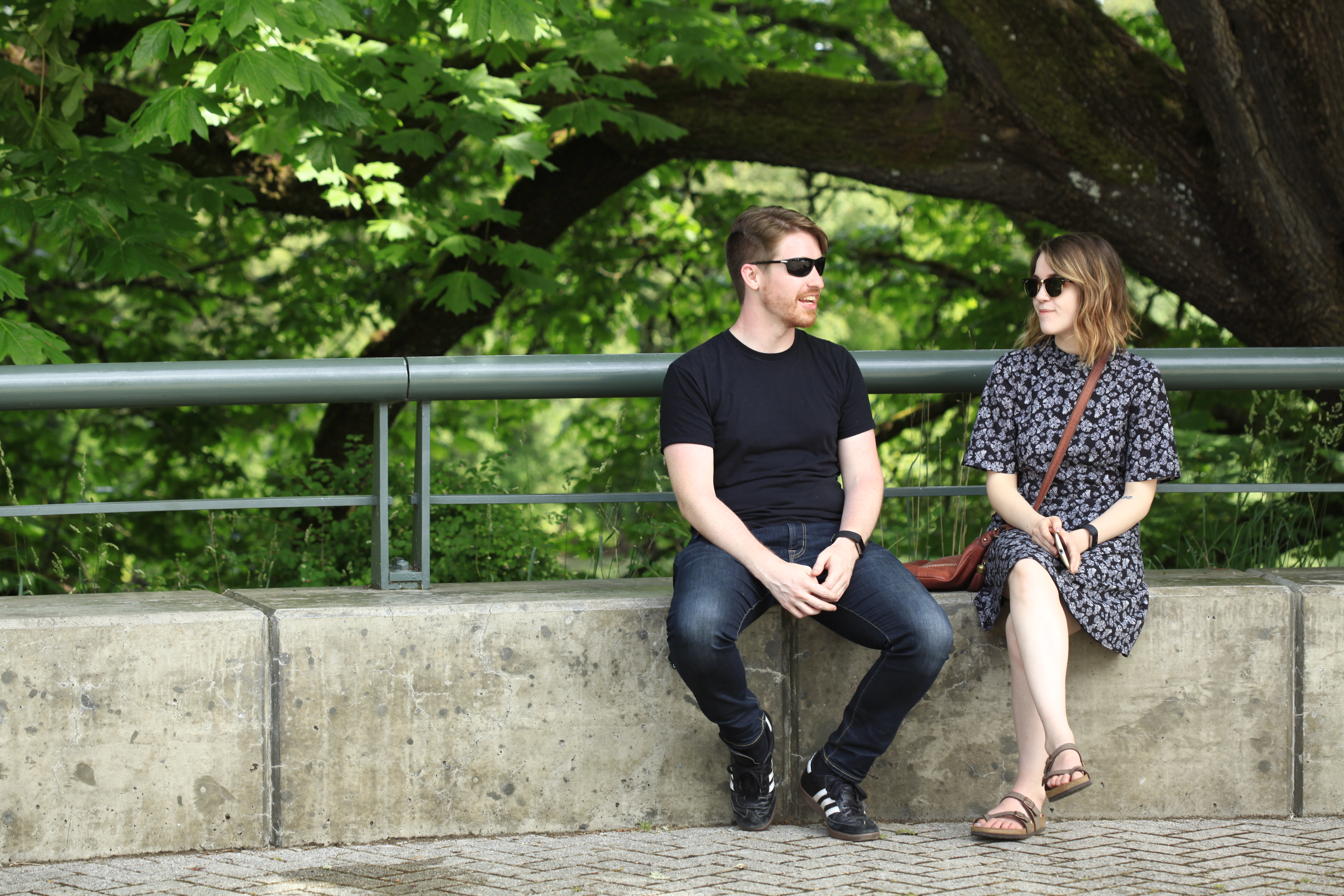 Students chat by the river on First Street in downtown Corvallis.